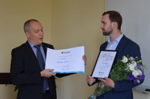 Two men with diplomas